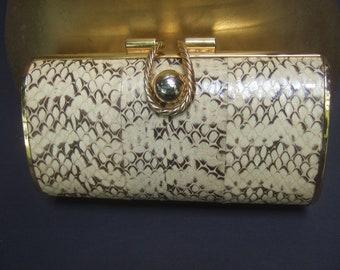 Sleek Snakeskin Gilt Metal Versatile Handbag c 1970s