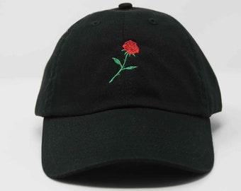 Unisex black cap with machine embroidered rose design