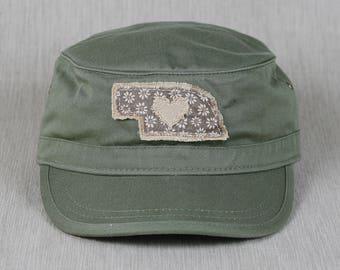 8536d5ca8a3 Green short-bill cadet cap with handmade Nebraska decal