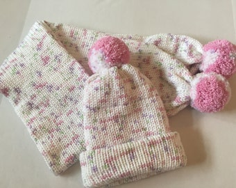 Pink and white knit hat and scarf
