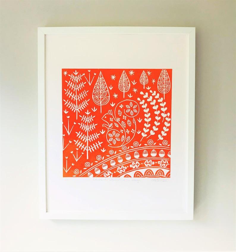 woodland animal linocut print limited edition Edward Squirrel in orange scandinavian print