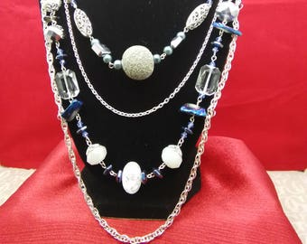 Blue 4 tier necklace with chain accents...