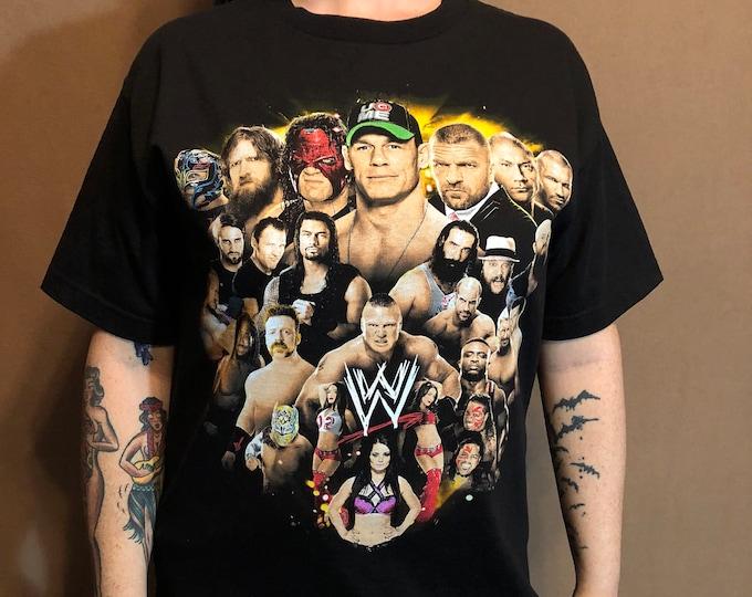 WWE Wrestling shirt (M) Monday Night Raw Smackdown NXT Triple H Daniel Bryan Brock Lesnar Randy Orton The Miz  BellaTwins Sin Cara Cesaro