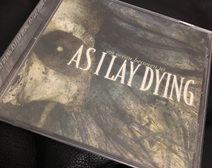 As I Lay Dying An Ocean Between Us CD Djent Metalcore Deathcore False Idol Veil of Maya Whitechapel Animals as Leaders Killswitch Engage