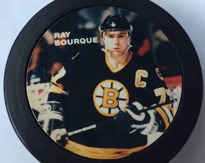 Ray Bourque Puck Boston Bruins Colorado Avalanche Hockey Stanley Cup NHL Hockey Cam Neely Andy Moog Boston Garden sports NESN defenseman