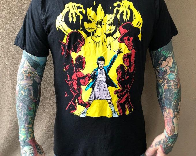 Stranger Things Eleven shirt (L) Netflix Sci Fi Horror Comics Winona Ryder Retro TV Television Tshirt Suspense Mystery X Files