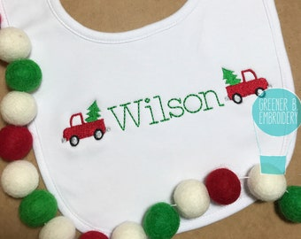 Personalised 1st christmas bib embroidered with the christmas tree and a name