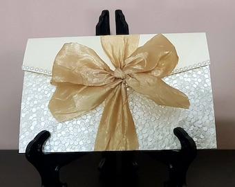 Handmade  cream pearlescent  pocketfold wedding invitation with taffeta ribbon