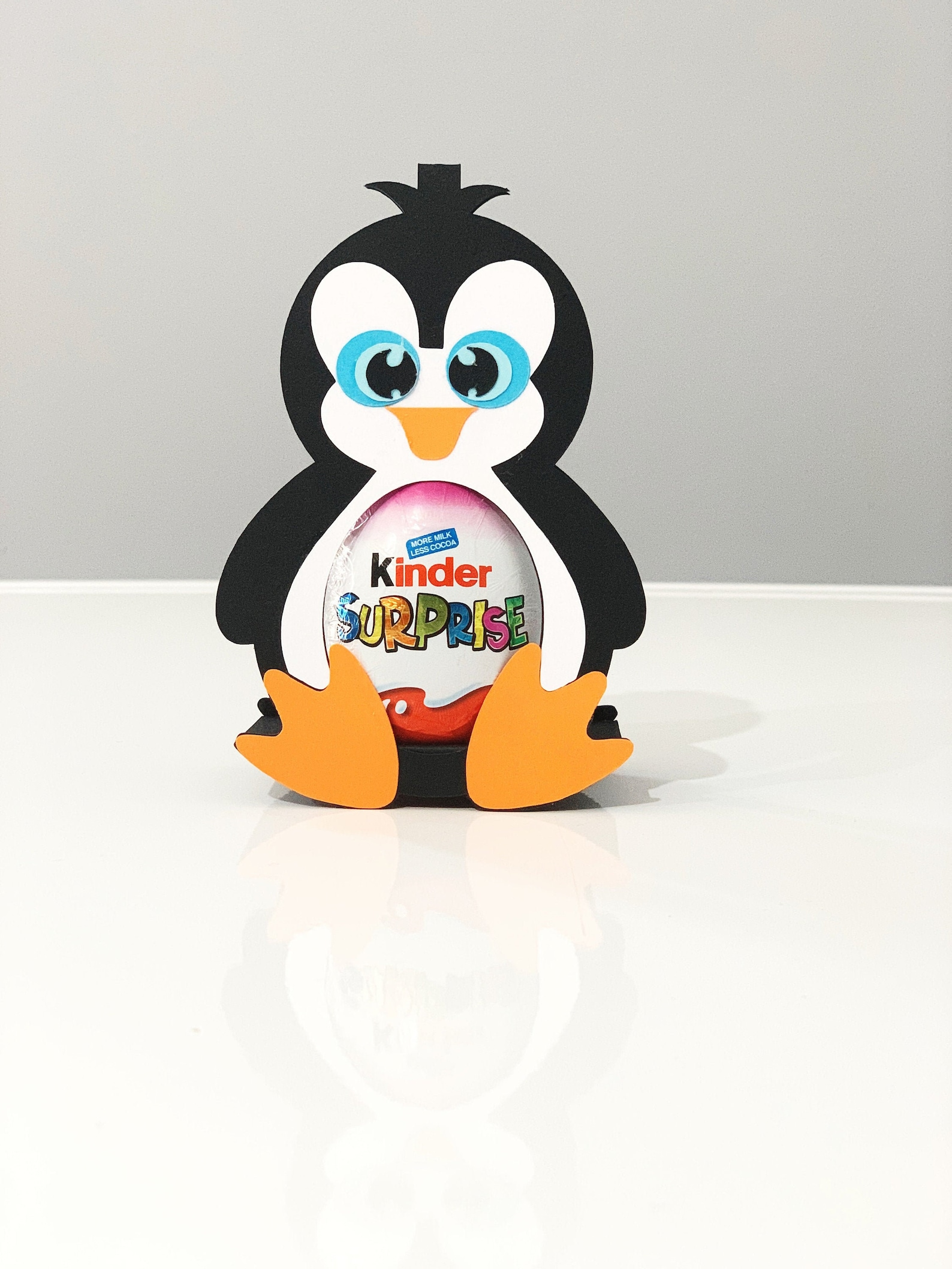 Penguin Kinder surprise chocolate holder with shut eyes and open eyes