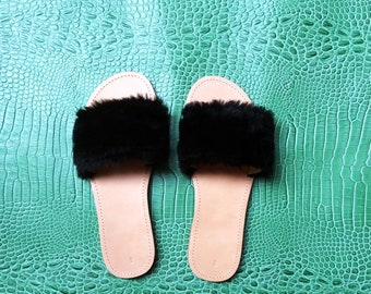 Cowhide and faux fur mules.