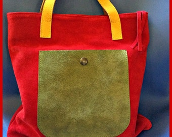 Suede leather handbag with cotton lining.