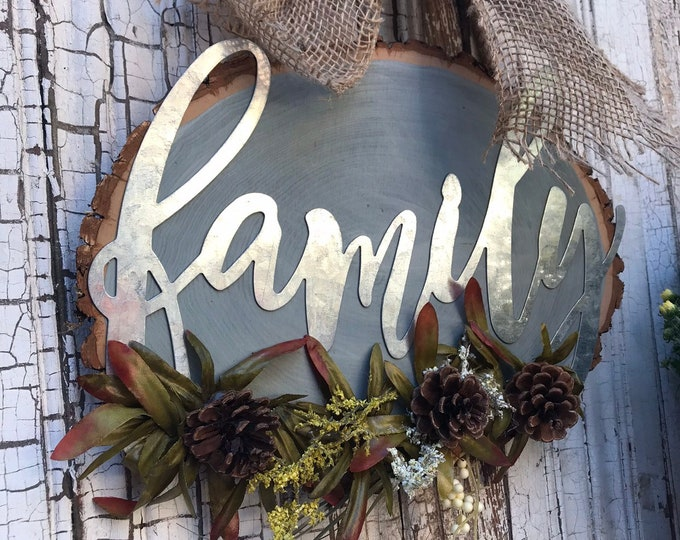 """Galvanized """"Family"""" Cut-out w/ attached greenery & Burlap Bow."""