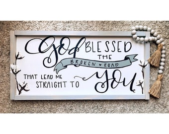 """God blessed the broken road that lead me straight to you."" w/ Painted Cotton Sign."