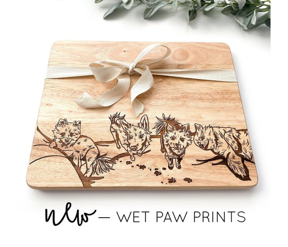 Custom engraved pet cutting boards. Pet cutting board. Dog cutting board. Custom engraved cutting boards. Gifts for dog lovers. Paw prints