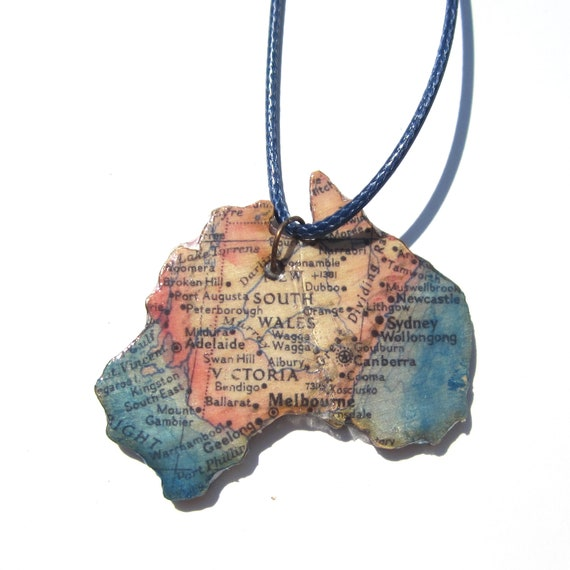 Lasercutted wooden world map necklace.