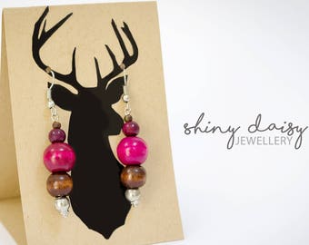 Bright elegant handmade earrings with wooden beads