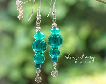 Bright elegant handmade earrings with glass beads and metal spiral