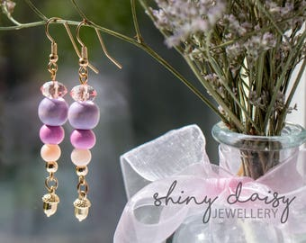 Bright elegant handmade earrings with faceted beads and golden acorn