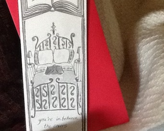 BETWEEN THE COVERS greeting card bookmark