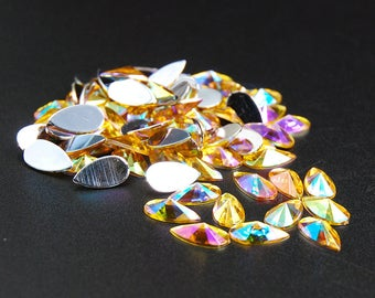 Hisenlee 100pcs pack 8x13mm Gold AB Topz Color Crystal Superior Pear Drop  Acrylic Rhinestone Flat back Glue on For Clothes Dress Decoration 88b774c40615