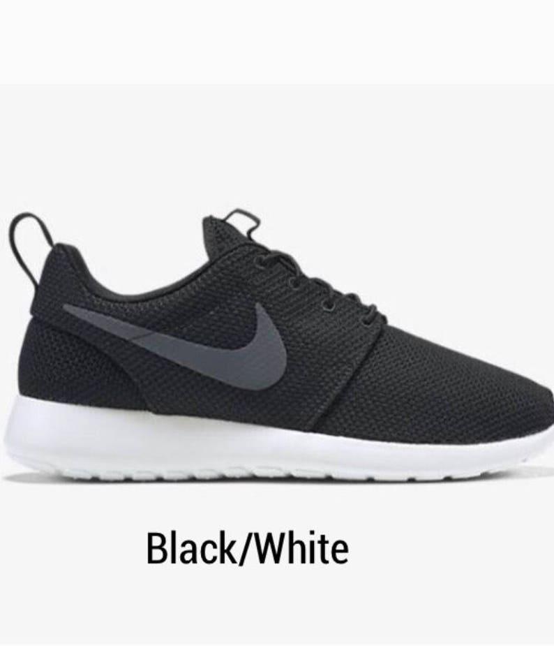 acbc93cd7f59b9 Gold and Black Custom Nike Roshe Shoes