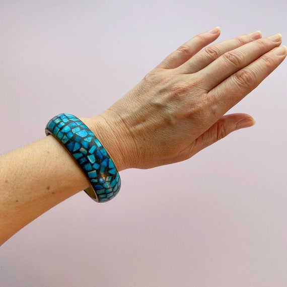 available in cream Anchor chain antique brass tone and faux braided leather bracelet light blue or bright blueturquoise
