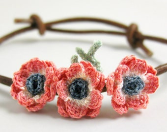 Boho flower bracelet. Bohemian floral bracelet adjustable. Leather cord flower jewelry. Red flower bracelet textile. Red anemone flower.