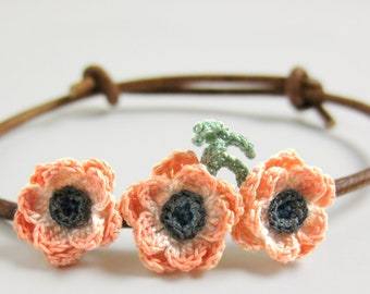 Boho flower bracelet. Bohemian floral bracelet adjustable. Leather cord flower jewelry. Peach flower bracelet textile. Peach anemone flower.