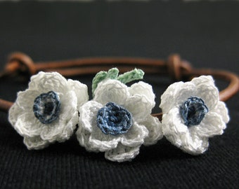 Boho flower bracelet. Bohemian floral bracelet adjustable. Leather cord flower jewelry. White flower bracelet textile. White anemone flower.