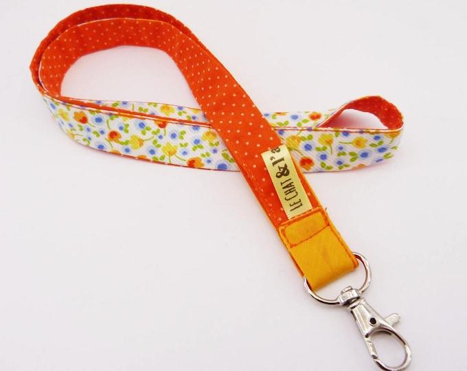 Cord key chain, orange and flowers