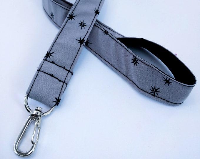 Cord key chain, black and grey stars