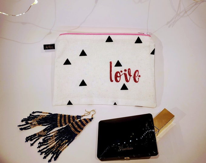 "White pouch with message ""Love"""