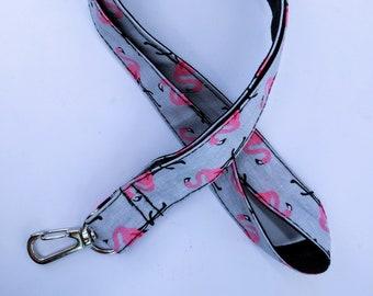 Key, Flamingo Pink and black cord
