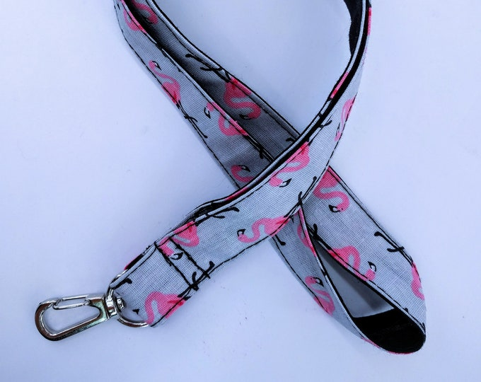 Key, Flamingo Pink and black cord