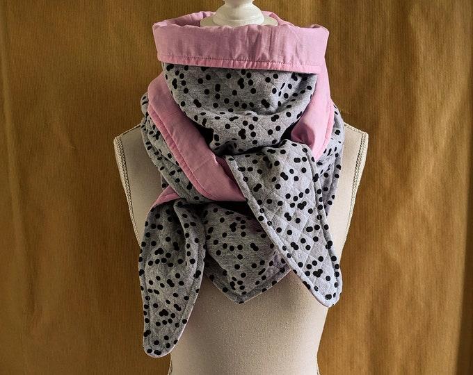 Black polka dots and pale pink sweatshirt