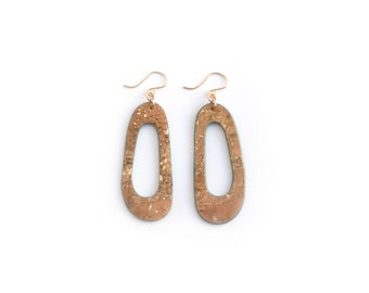 Cork earrings with gold flecks and teal edging. Lightweight statement jewelry. 14/20 gold-filled ear wires. Droopy shape earrings.