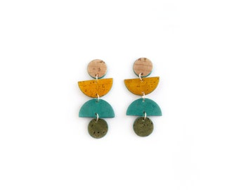 Swingy, geometric cork earrings. Bold colors, lightweight statement jewelry. Natural, mustard yellow, teal + olive green cork earrings.