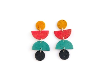 Swingy, geometric cork earrings. Bold colors, lightweight statement jewelry. Mustard yellow, red, teal and black cork leather jewelry.