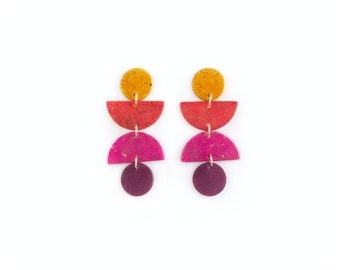 Swingy, geometric cork earrings. Bold colors, lightweight statement jewelry. Mustard yellow, red, pink and violet cork leather jewelry.
