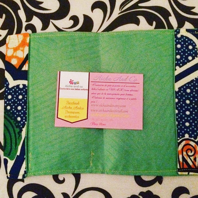 Prot\u00e9g\u00e9 Passport wax blue green yellow orange umbrella