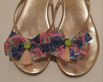Lilly Fabric inspired shoe bows in garden pink and blue and green print with hot green buttons and peach tassels
