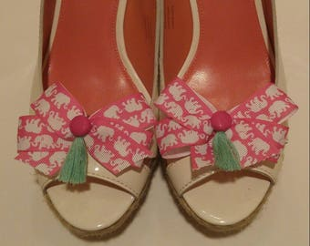 White elephants on pink ribbon Lilly fabric inspired shoe accessory shoe bows with hot pink buttons and green tassels