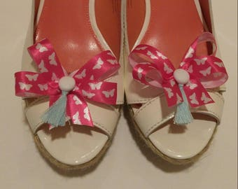 Hot pink ribbon shoe bows with white butterflies shoe accessories with white homemade buttons and light blue tassels