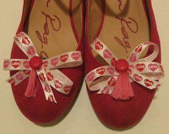 Valentine's Day conversation hearts love ribbon shoe bows with red buttons and dark pink tassels