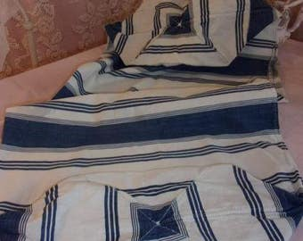 A blue Duffel or old pillow ticking striped cover