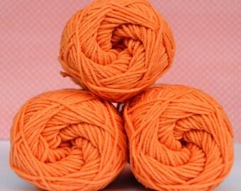 Kacenka - soft cotton/acrylic yarn for crochet and knitting, Orange color, No. 2254, 1 ball/50 g, Producer NCT