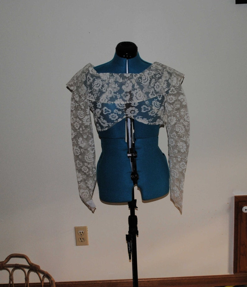 Back V Neckline with Button and Loop Closure Front Cowl Neckline Vintage 1950s Fitted Lace Bolero Jacket