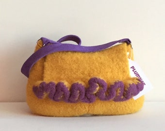 ARYA felted handbag in in yellow, with purple ruffle detail.