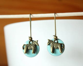 bronze earrings with blue sequin and horse show