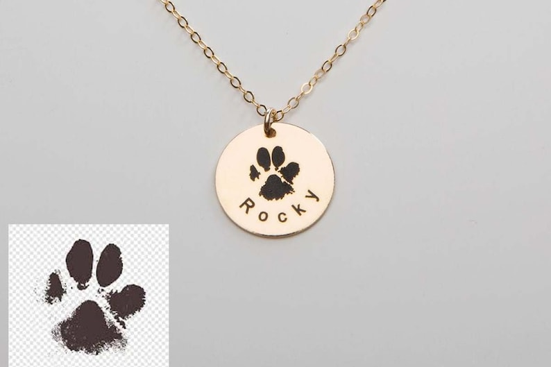 Paw Print Pendant in Rose Gold with the Name Rocky engraved.